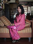 "JAKARTA, INDONESIA, MARCH 2013: Yulianus Rettoblaut (Mami Yuli) poses for a portrait in the livingroom of her ""house for transgender elderly"", Depok Baru,outskirts of Jakarta."