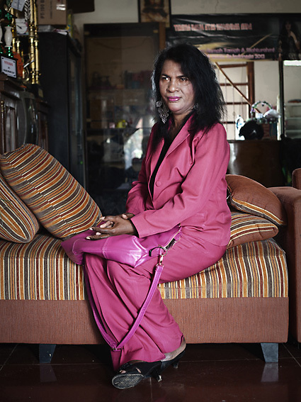 "JAKARTA, INDONESIA, MARCH 2013: Yulianus Rettoblaut (Mami Yuli) poses for a portrait in the livingroom of her ""house for transgender elderly"", Depok Baru,outskirts of Jakarta."
