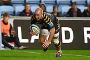 Wasps scrum half Dan Robson (9) scores a try during the Gallagher Premiership Rugby match between Wasps and Bath Rugby at the Ricoh Arena, Coventry, England on 2 November 2019.