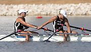 Georgina and Caroline Evers-Swindell hold hands at the end of the race  winning the Womens Double Sculls Final, Schinias Olympic Rowing Complex, Athens, Greece, Saturday,21 August 2004 <br />