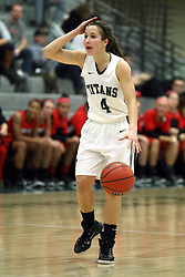 10 January 2015:  Rebekah Ehresman runs the offense during an NCAA women's division 3 CCIW basketball game between the Carthage Reds and the Illinois Wesleyan Titans in Shirk Center, Bloomington IL