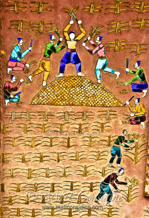 A colorful mosaic on the wall of a temple showing workers reaping a crop of corn.<br /> (Photo by Matt Considine - Images of Asia Collection)