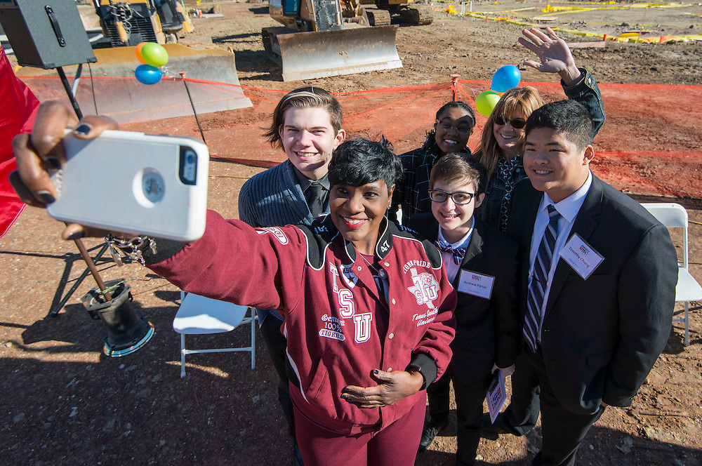 Houston ISD Trustee Wanda Adams takes a selfie with students during a groundbreaking ceremony for the new Energy Institute High School, November 19, 2016.