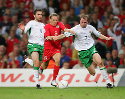 CARDIFF, WALES - Wednesday, September 8, 2004: Wales' Craig Bellamy in action against Northern Ireland's Damien Johnson (L) and Mark Clyde during the Group Six World Cup Qualifier at the Millennium Stadium. (Pic by David Rawcliffe/Propaganda)