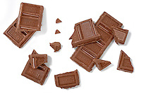 broken chocolate hersheys pieces photographed on a white background