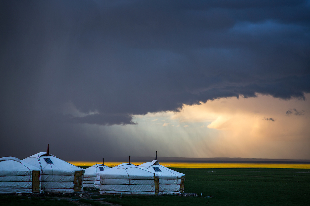 Rain showers the Gobi Desert outside of the Three Camel Lodge on July 31, 2012. © 2012 Tom Turner Photography.