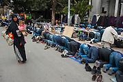 Prayers in the street outside the Salafi mosque El Fath Tunis..Prière de rue a l'extérieur du mosquée salafiste El Fath, Tunis