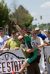 Colorado State's Phil Mann celebrates with his coach after winning the Men's Division I criterium.  The 2007 USA Cycling Collegiate Road Championship criterium was held in downtown Lawrence, Kansas on May 13, 2007.