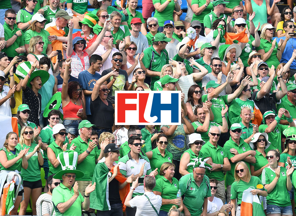 Ireland fans cheer during the men's field hockey Germany vs Ireland match of the Rio 2016 Olympics Games at the Olympic Hockey Centre in Rio de Janeiro on August, 9 2016. / AFP / MANAN VATSYAYANA        (Photo credit should read MANAN VATSYAYANA/AFP/Getty Images)