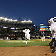 Yankees players take the field wearing number 42  during Jackie Robinson Day celebrations during the New York Yankees V Chicago Cubs, double header game two at Yankee Stadium, The Bronx, New York. 16th April 2014. Photo Tim Clayton