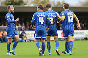 Callum Kennedy of AFC Wimbledon celebrates with team during the The FA Cup match between AFC Wimbledon and Forest Green Rovers at the Cherry Red Records Stadium, Kingston, England on 7 November 2015. Photo by Stuart Butcher.