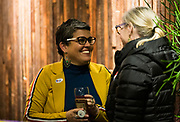 Ananda Mirilli, left, speaks with former school board member Mary Burke at the Madison School Board election watch party at Robinia Courtyard in Madison, Wisconsin, Tuesday, Feb. 19, 2019.