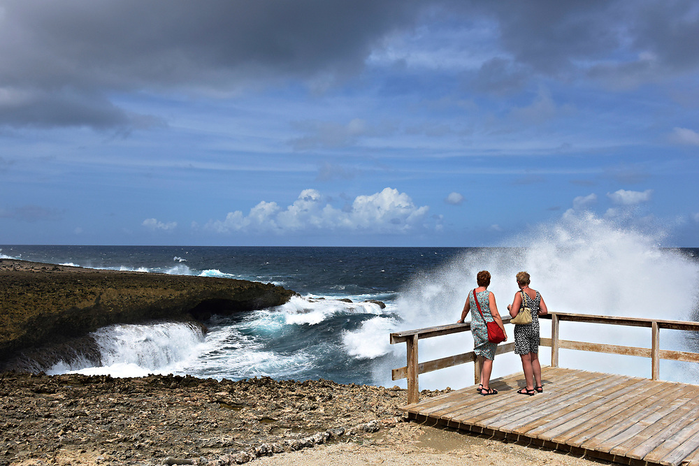 WILLEMSTAD, CURACAO - DECEMBER 12, 2014: Visitors watch huge waves crash into the Boca Tabla at Shete Boka National Park in Curacao's Westpunt region. (photo by Melissa Lyttle)