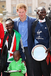Prince Harry with  Wilson Kipsang  and Mary Keitany winners of the London Marathon, along with Mary's son Jared (2) Sunday 22nd April 2012  Photo by: Stephen Lock / i-Images