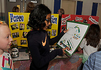 Aubrey Vliet and Jiya Patel explain force and motion in simple machines as their 3rd grade STEAM project on display at Gilford Elementary School Tuesday evening.  (Karen Bobotas/for the Laconia Daily Sun)
