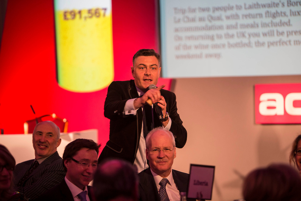 Auctioneer Richard Brierley running the evenings live auction. ActionAids fund raising event 2013: Call My Wine Bluff is a high-spirited take on the classic TV game show with an all-star panel pitting their wits against the audience, but this time not over the meaning of words, but the origin of the wine.