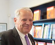 "Rockville Centre, New York, USA. April 201, 2018. Rep. STEVE ISRAEL browses through books before start of event for Nassau County debut of the former Congressman's (NY - Dem) newest novel ""Big Guns"" - a satire of the strong gun lobby, weak Congress, and small Long Island town. The talk and book signing was held at Turn of the Corkscrew Books & Wine store."