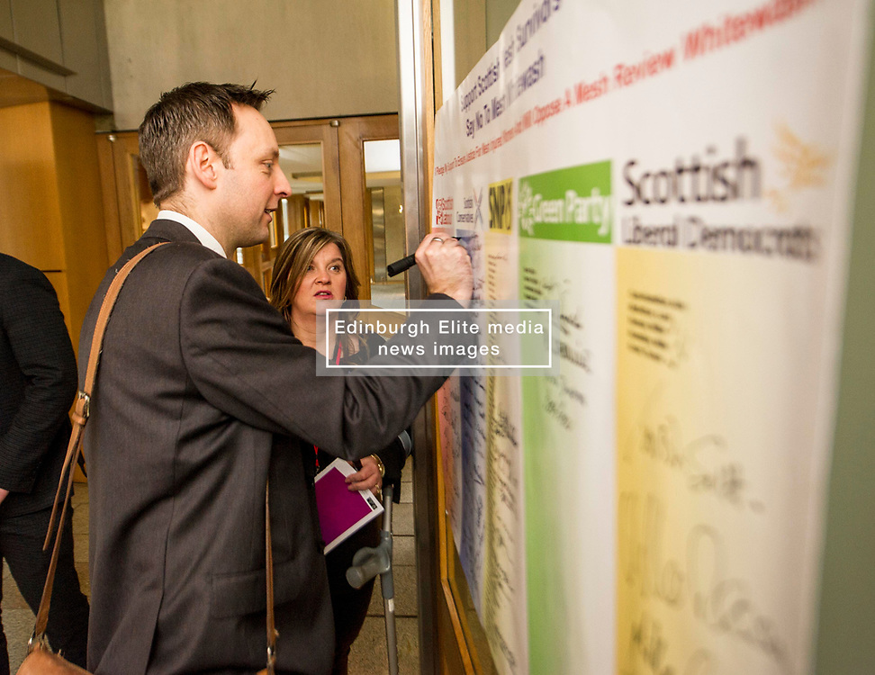 Pictured: Liam Kerr, MSP, signs the pledge watched by Claire Daisley<br /> Thousands of Scottish women have been fitted with polypropylene transvaginal mesh to treat pelvic organ prolapse or stress urinary incontinence. As a result women in every Scottish constituency have been severely injured or permanently disabled following this procedure, some have lost organs, many their careers and their relationships.  The women and their families  are asking MSPs to sign a pledge <br /> <br /> Ger Harley | EEm 16 March 2017
