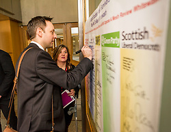 Pictured: Liam Kerr, MSP, signs the pledge watched by Claire Daisley<br /> Thousands of Scottish women have been fitted with polypropylene transvaginal mesh to treat pelvic organ prolapse or stress urinary incontinence. As a result women in every Scottish constituency have been severely injured or permanently disabled following this procedure, some have lost organs, many their careers and their relationships.&nbsp; The women and their families  are asking MSPs to sign a pledge <br /> <br /> Ger Harley | EEm 16 March 2017