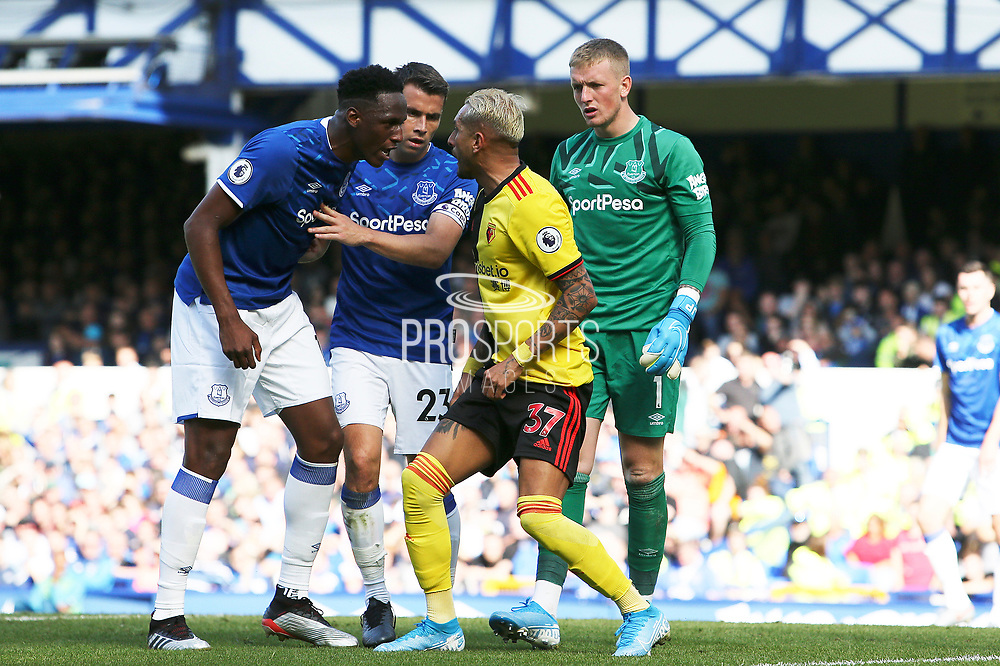 Watford midfielder Roberto Pereyra (37) and Everton defender Yerry Mina (13) exchange words during the Premier League match between Everton and Watford at Goodison Park, Liverpool, England on 17 August 2019.