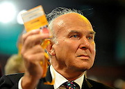 © Licensed to London News Pictures. 17/09/2011. BIRMINGHAM, UK. Vince Cable votes in a motion. The Rt Hon Dr Vincent Cable MP Business Innovation and Skills Secretary delivers his speech to the Liberal Democrat Conference at the Birmingham ICC today (19 Sept 2011): Stephen Simpson/LNP . Photo credit : Stephen Simpson/LNP