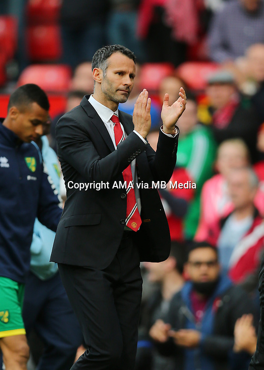 Ryan Giggs interim manager / assistant coach of Manchester United applauds the crowd after the 4-0 victory over Norwich City in his first game as manager