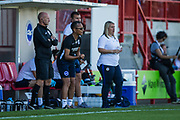 Hope Powell, Manager of Brighton & Hove Albion FC & Emma Hayes, Manager of Chelsea FC on the sidelines during the FA Women's Super League match between Brighton and Hove Albion Women and Chelsea at The People's Pension Stadium, Crawley, England on 15 September 2019.