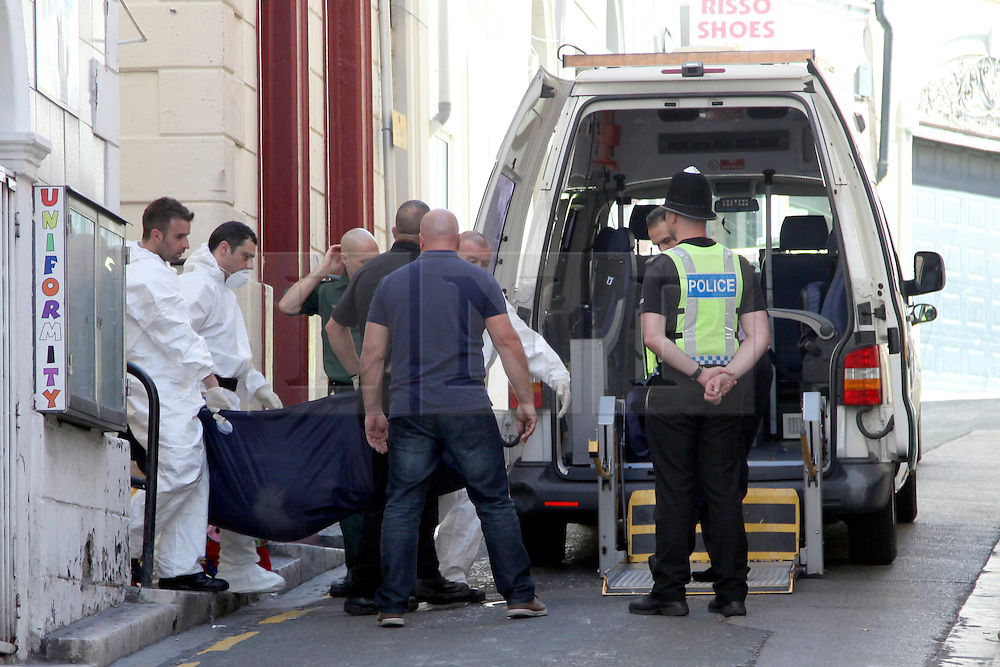 **PICTURE SHOWS A BODY BEING REMOVED FROM THE SCENE** © London News Pictures. 31/03/2015. Police at the scene in Gibraltar where officers discovered the bodies of four individuals, a 31-year-old British male, a 37-year-old Spanish woman, a 4-year-old girl and a 6-week-old girl, all believed to be of the same family. Photo credit: Donovan Torres/LNP