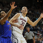 Breanna Stewart, (right), UConn, challenges for a rebound with Jessica January, DePaul, during the UConn Vs DePaul, NCAA Women's College basketball game at Webster Bank Arena, Bridgeport, Connecticut, USA. 19th December 2014