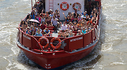 London, July 18th 2016. Tourists enjoy London's hot sunshine as they cruise down the River Thames.