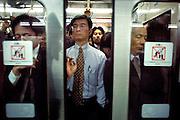Metro doors closing in a crowded Tokyo Metro train
