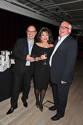 Left to right, NEIL SINCLAIR, JOAN COLLINS and CHRISTOPHER BIGGINS at a party to celebrate the publication of her  autobiography - The World According to Joan, held at the British Film Institute, South Bank, London SE1 on 8th September 2011.