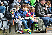 Young FGR fans eating chips during the EFL Sky Bet League 2 match between Forest Green Rovers and Lincoln City at the New Lawn, Forest Green, United Kingdom on 2 March 2019.