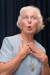Elderly woman singing,