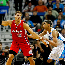 Mar 27, 2013; New Orleans, LA, USA; Los Angeles Clippers power forward Blake Griffin (32) is guarded by New Orleans Hornets power forward Anthony Davis (23) during the first quarter of a game at the New Orleans Arena. Mandatory Credit: Derick E. Hingle-USA TODAY Sports