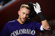 Apr 29, 2016; Phoenix, AZ, USA; Colorado Rockies shortstop Trevor Story (27) takes off his helmet after hitting a two run home run in the fifth inning against the Arizona Diamondbacks at Chase Field. Mandatory Credit: Jennifer Stewart-USA TODAY Sports