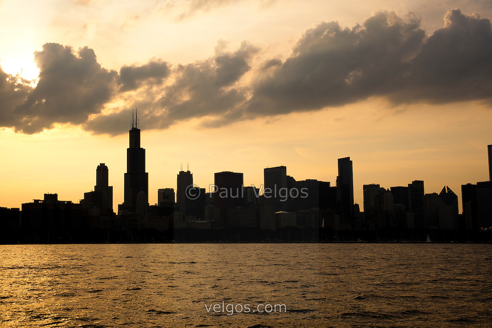 Photo of Chicago sunset downtown skyline silhouette with Willis Tower (Sears Tower) and other  downtown Chicago buildings. Picture is high resolution and was taken in 2010.
