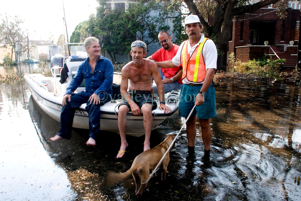 05 Sept  2005. New Orleans, Louisiana. Post hurricane Katrina.<br /> Animal rescue boat. Local man Jimmy Delery (rt) and his merry band of locals assist in the search and rescue animals from the devastating floods in Uptown New Orleans.<br /> Photo; &copy;Charlie Varley/varleypix.com