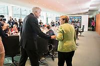 29 AUG 2018, BERLIN/GERMANY:<br /> Horst Seehofer (L), CSU, Bundesinnenminister, und Angela Merkel (R), CDU, Bundeskanzlerin, im Gespraech, vor Beginn der Kabinettsitzung, Bundeskanzleramt<br /> IMAGE: 20180829-01-045<br /> KEYWORDS: Kabinett, Sitzung, Gespr&auml;ch