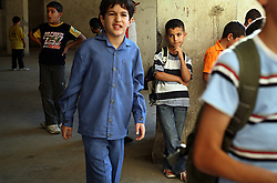 Iraqi refugee Hussein Thamer, 8, attends the first day of school at The Samir Rifai Elementary School for Boys in Amman, Jordan, Aug. 19, 2007. His family fled the violence in Baquba, Iraq two years ago and are waiting for asylum from the U.N. Refugee Agency so they can finally make a permanent home.