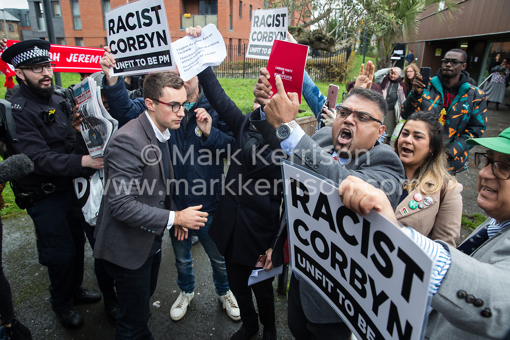 London, UK. 26 November, 2019. Activists from the Campaign Against Antisemitism and supporters of Jeremy Corbyn protest outside the Bernie Grant Arts Centre in Tottenham before the arrival of Labour Party leader Jeremy Corbyn to launch Labour's new Race and Faith Manifesto.