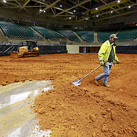 Thomas Wells | BUY AT PHOTOS.DJOURNAL.COM<br /> Pete Sprouse waits for another load of dirt to arrive at the BancorpSouth Arena on Wednesday as Paul Smithey uses a bulldozer to spread the dirt for this weekends rodeo.