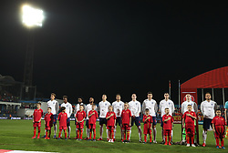 England players line up prior to game