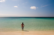 A lone woman in a bikini in the sea at Playa Ancon, Trinidad, Cuba