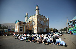 Image ©Licensed to i-Images Picture Agency. 28/07/2014. Kabul, Afghanistan. <br /> 61981783<br /> Afghan men attend Eid-al-Fitr prayers at a mosque in Kabul, Afghanistan, on July 28, 2014. Muslims around the world celebrate Eid al-Fitr, marking the end of the fasting month of Ramadan. Picture by  imago / i-Images<br /> UK ONLY