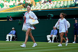 LONDON, ENGLAND - Tuesday, July 1, 2014: Petra Kvitova (CZE) and Barbora Zahlavova Strycova walk onto court before the Ladies' Singles Quarter-Final match on day eight of the Wimbledon Lawn Tennis Championships at the All England Lawn Tennis and Croquet Club. (Pic by David Rawcliffe/Propaganda)