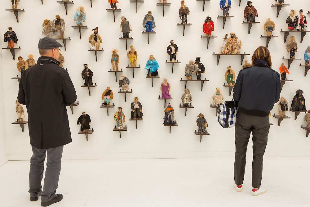 "New York, NY - 6 May 2016. Frieze New York art fair. A wall filled with figures made of natural materials by Jos de Gruyter and Harald Thys, titled ""I piccoli pupazzi sporchi di Pruppà (The small dirty puppets from Pruppa) in the gallery of Gavin Brown Enterprises."