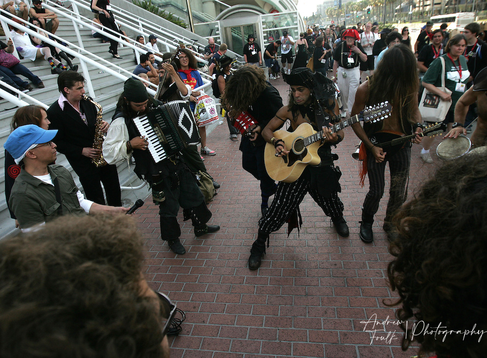 "Andrew Foulk/ Zuma Press.July 24, 2009, San Diego, California, USA. Comic Con. A band of ""Pirate"" musicians perform outside the San Diego Convention center for  Comic Con attendee , during day two of the 40th annual San Diego International Comic Con."