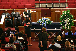 14 May 2014. New Orleans, Lousiana. <br /> Funeral for teenage shooting victim Miqual Jackson at the New Hope Baptist Church. Victim's teacher hugs victim's mother. 14 years old Jackson was shot in the back of the head May 5th and died shortly afterwards. His 15 year old brother  Lamichael was hit in the leg and survived. 52 year old Gregory Johnson is wanted on 1st degree murder charges. Randy Pittman, 49, an associate of Johnson's was arrested on 3 counts of being a principal to 1st degree murder. The New Hope Baptist Church witnessed the funeral of 1 year old Londyn Samuels who was also gunned down in cold blood on the streets of New Orleans 8 months ago.<br /> Charlie Varley/varleypix.com