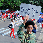 A man looks to buy tickets before an NCAA college football game between Mississippi and Texas in Oxford, Miss., Saturday, Sept. 15, 2012. (Photo/Thomas Graning)